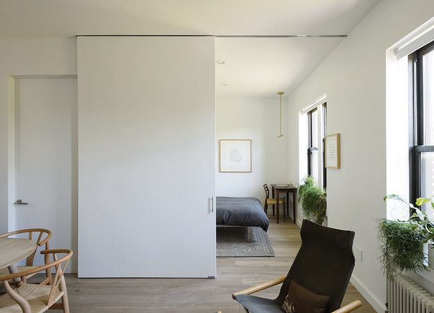 Replace doors with sliding walls to let your space breathe. | 31 Tiny House Hacks To Maximize Your Space