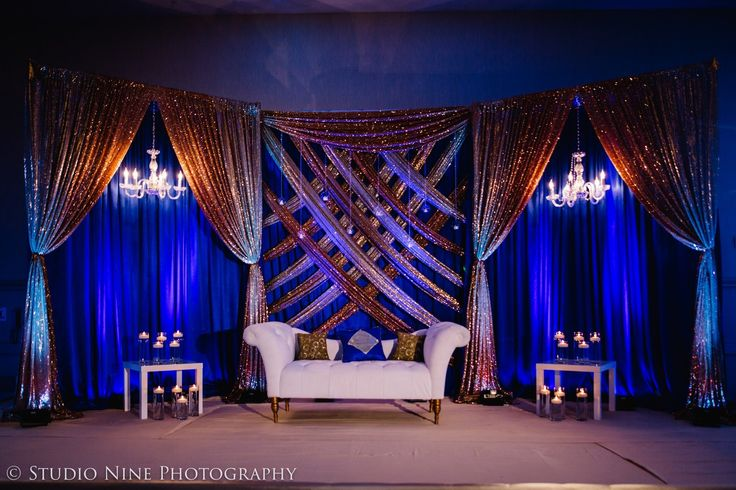 Royal blue and gold reception backdrop