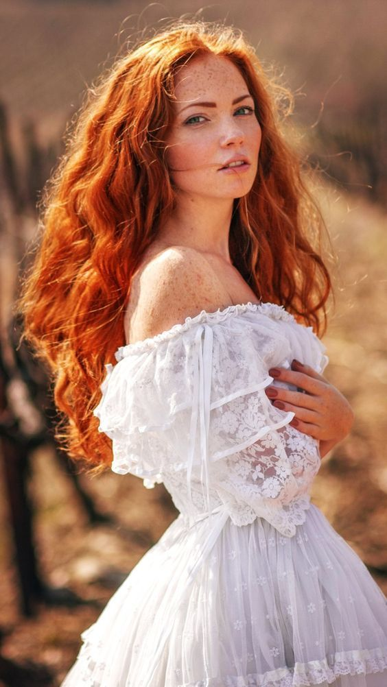 stunning red hairy fire on a an angelic white dress