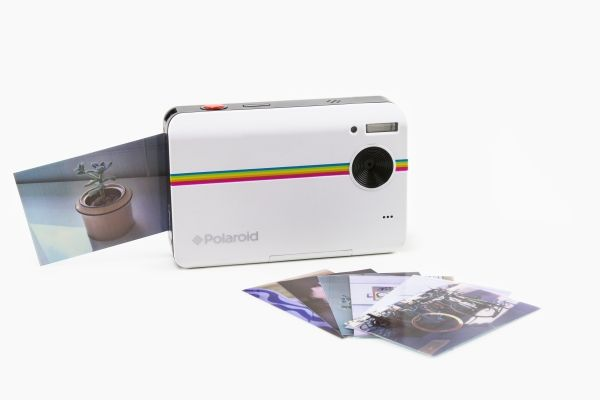 The Polaroid Z2300 - A digital camera that makes sticky backed instant prints at the push of a button. ($160.00, http://photojojo.com/store)