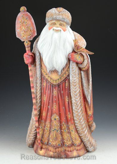 Elegant Jeweled Santa Claus -This regal Santa reigns over the North Pole with a kind smile and a generous heart. Dressed in a flowing full length coat, Santa's garment is accented with 85 embedded semi precious gems and hints of gold and copper filigree.