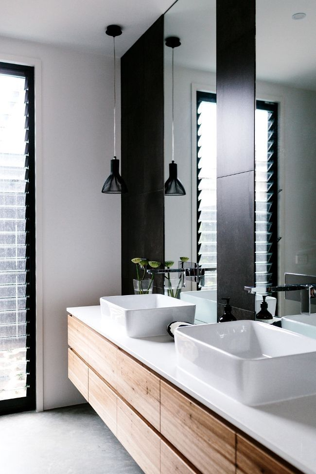 Modern bathroom decor with full height windows, lots of mirrors, and black / wood / white decor. I especially like the bowl-shaped sitting sinks!