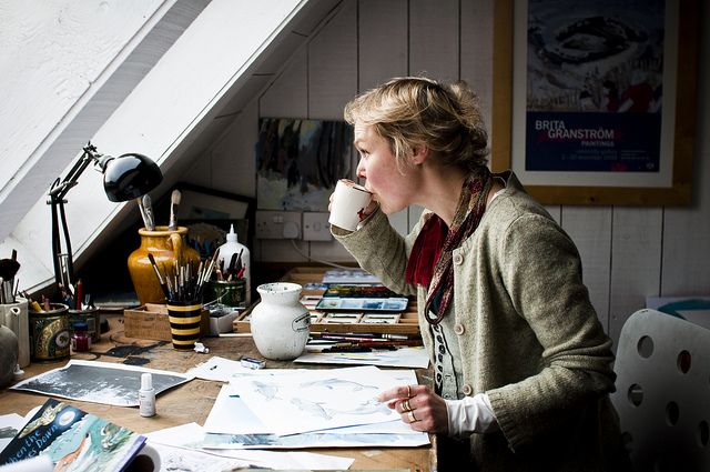 i want to be in this point in life. sipping coffee while drawing & painting beautiful work, having a vast space to work on; art supplies aplenty at your reach, looking elegantly natural, all while overlooking something grand. (here it's the ocean). Brita Granström illustrates children's books. Photographed by Diana Pappas.