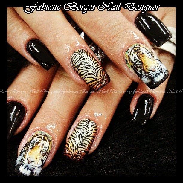 Tiger nail art. I like the ring fingers.