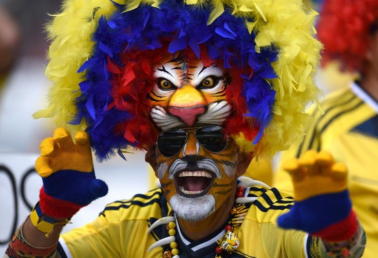 This Colombia fan is roaring with team spirit!