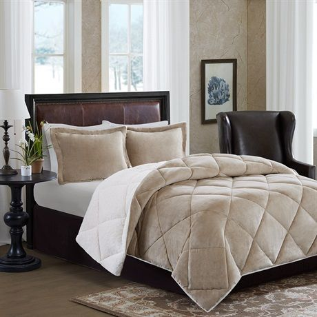 Stay warm all night long with the Plush Comforter Mini Set by Bombay.  The comforter features a solid tan micro velour on one side and reverses to a plush, warm berber fabric.  Two matching shams complete the set.