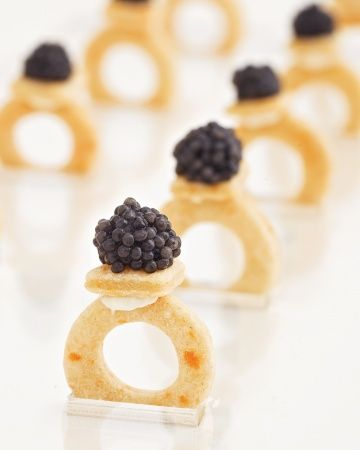 "Witty (and delicious) caviar ""gems"" top cracker rings for this fun bridal shower snack"