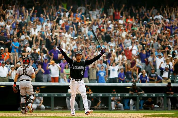 WALK-OFF VICTORY:   Carlos Gonzalez of the Rockies celebrates after walking in the ninth inning with the bases loaded that gave the Rockies 4-3 victory over the Giants on Sept. 4 in Denver, Colorado.