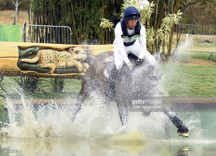 US rider Clark Montgomery on Loughan Glen competes in the Eventing's Individual Cross Country of the Equestrian during the 2016 Rio Olympic Games at the Olympic Equestrian Centre in Rio on August 8, 2016. / AFP / John MACDOUGALL