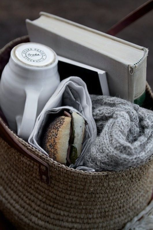 Bundling up and going out for a picnic to enjoy the chilly sunshine