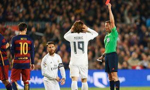 April 26th. 2016: Sergio Ramos kneels beneath the 21st. red card of his career received for a foul on Luis Suarez as Real Madrid beat Barcelona 2-1