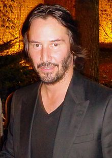 Have dinner with Keanu Reeves and discuss his philosophy of life.