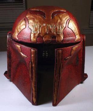 custom mandalorian helmet with etched or raised mythosaur