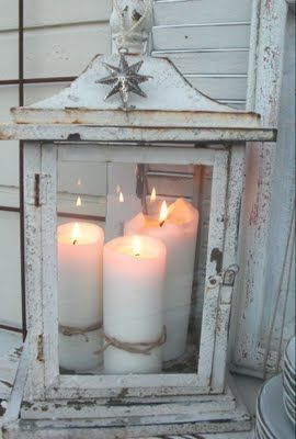 Love this shabby chic lantern with the candles glowing in it.