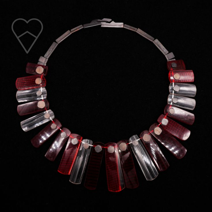 Watermelon reflector neck piece. Silver, oxidised copper, polycarbonate (recycled car taillight lens), stainless steel.
