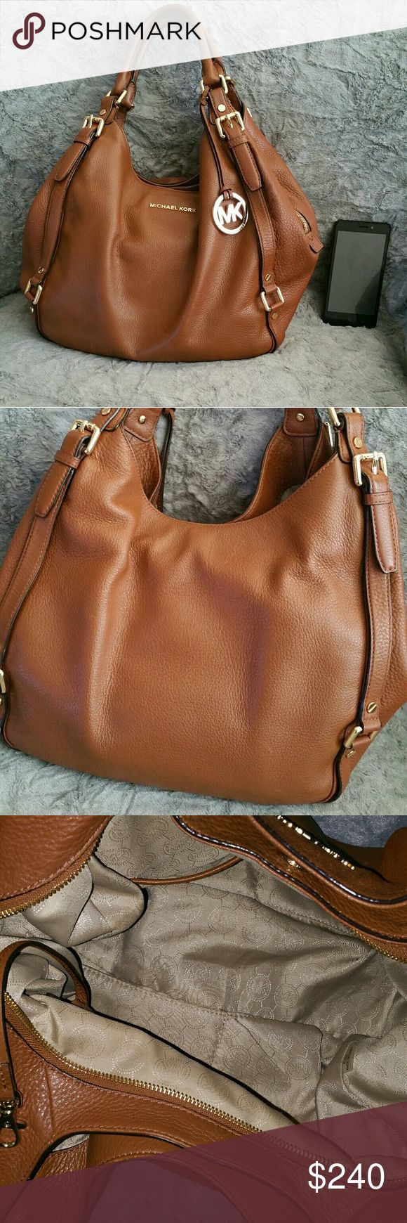 Michael Kors Large Bedford Bag Saddle bag brown leather, awesome condition, many pockets inside, all snaps work, some little ink pen marks inside, zipper works perfectly, some light wear but it's beautiful.  I don't have a bag or a box but it is 100% authentic. And just so you fellow poshers know,  I actually bought a $400 Gucci purse thru here thinking it was real and it was not!  I told Posh about it and they  cleared it up and I sent that thing back! So this girl only buys the real deal…