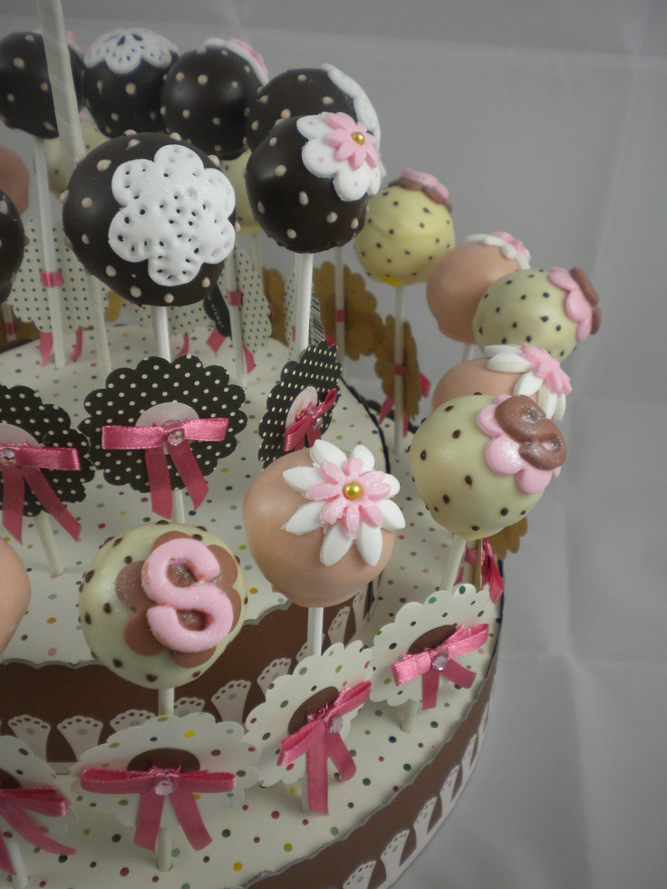 sweetartreats.com: fondant flower cake pops on a decorated stand