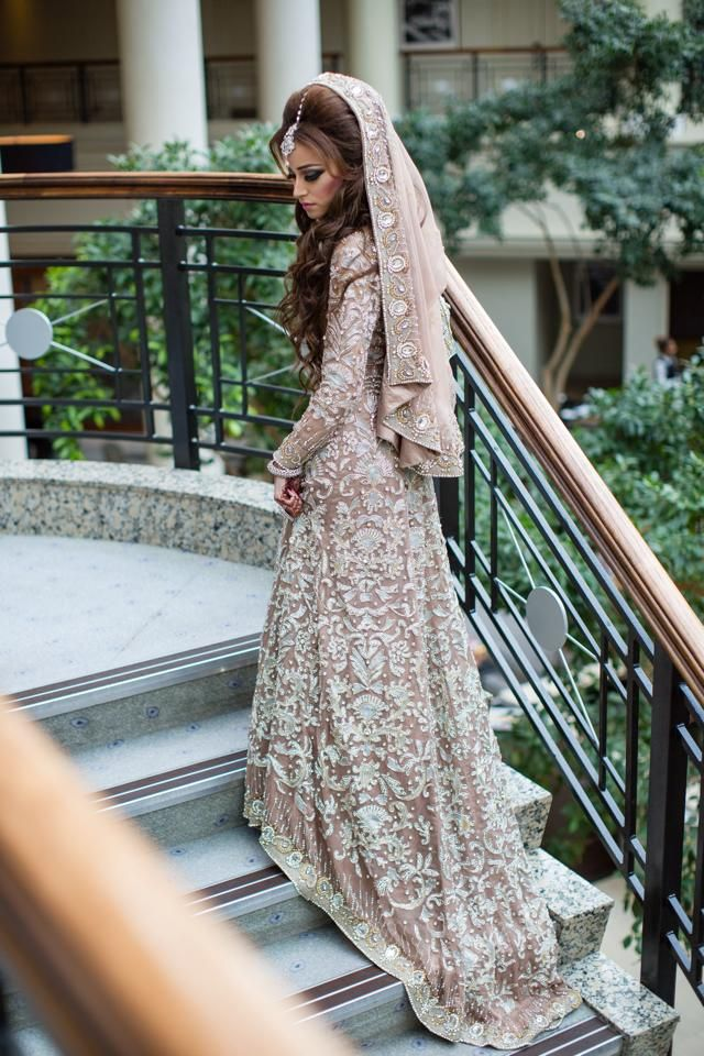 Photo via Naeem Khan east west infusion wedding dress, beautiful long brown wavy hair