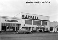 Image No: NC-7-713 Title: Mayfair Theatre, Cardston, Alberta. Date: November 26, 1951 Photographer/Illustrator: Atterton Studio, Cardston, Alberta Remarks: Showing movie 'Cavalry Scout' starring Rod Cameron. Cars parked out front.