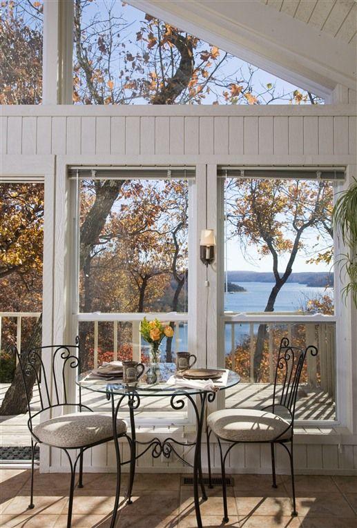Romantic Glass-Front Lake View cottages overlooking mountainous Beaver Lake in the Ozark Mountains in Eureka Springs, Arkansas.