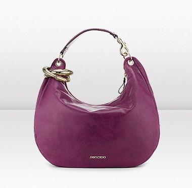Jimmy Choo - SOLAR, a slouchy and spacious hobo style shoulder bag, in softest plum calf leather with intertwining golden bangles.
