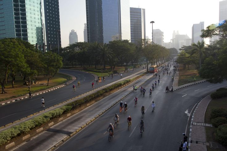 People ride their bicycles during a weekly car-free day in Jakarta. Photograph: Eddy Purwanto/Demotix/Corbis