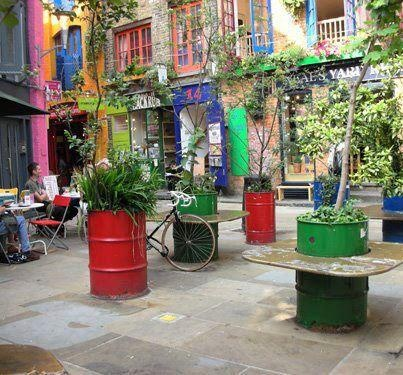 Reuso de tambores de lata como maceteros jardines y for Jardines en lata