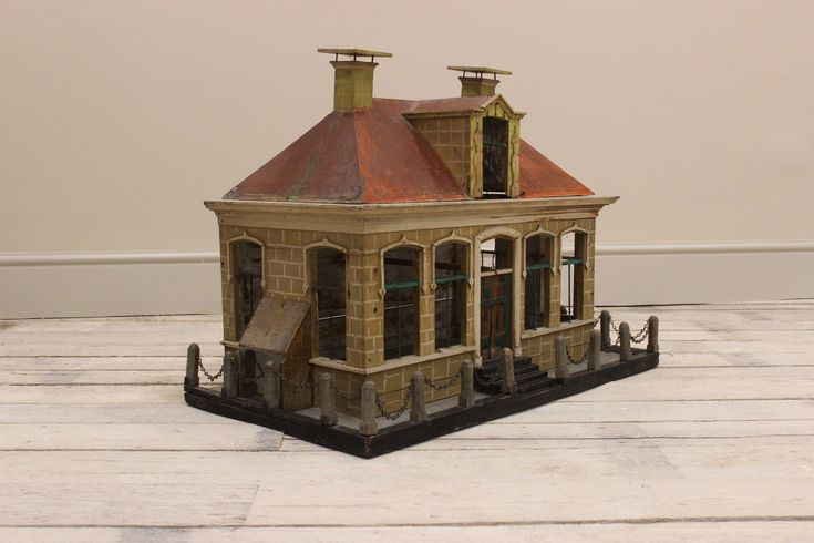 A very charming, 19th century Belgium Pigeons cage in the shape of a house, retaining its original condition and paint.