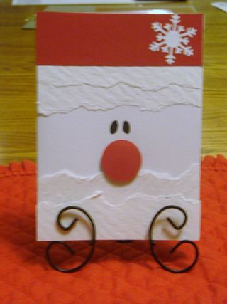 "How cute is this? From artist: Standard card base. Cut 4 1/4"" x 2"" strip of red cardstock. Tear 4-5 strips of white. Scrunch & smooth for texture, use embossing plate, or use textured wallpaper (white textured sheets). Punch snowflake. With black marker, make eyes. Punch 1"" circle for nose."