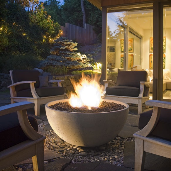 "The Solus 36"" Hemi Firebowl stands at 16.5"" tall, 36"" across and available as natural gas (75,000 BTUs) or liquid propane (80,000 BTUs). It is the perfect way to add spark to more intimate outdoor spaces. Handcrafted in smooth high-performance concrete, this serene outdoor fire pit cradles its flame in a beautifully sculptural concavity."