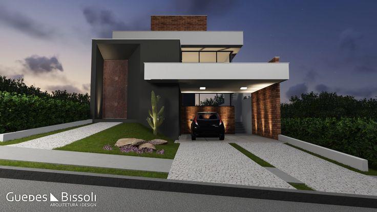Casa térrea com fachada imponente em tons neutros e tijolinho à vista como revestimento.