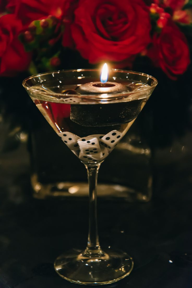 Floating candles and dice in martini glass - a fun decorative table accent for formal event.