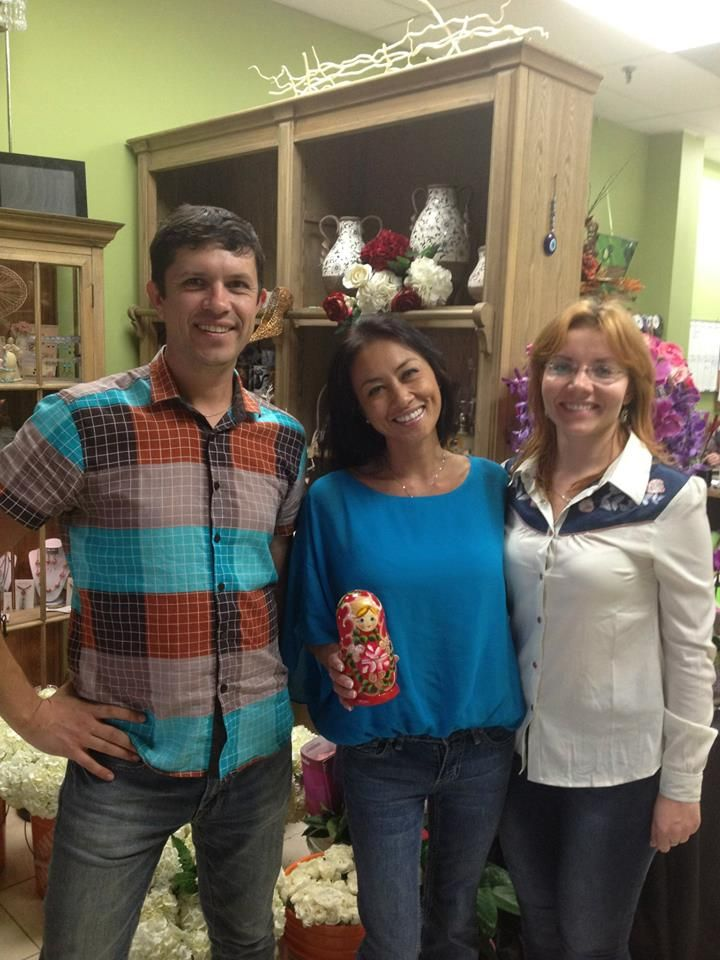 Karen Tran with traditional Russian gift - Matryoshka at Flowers Time Floral Studio with Alina and Yury.
