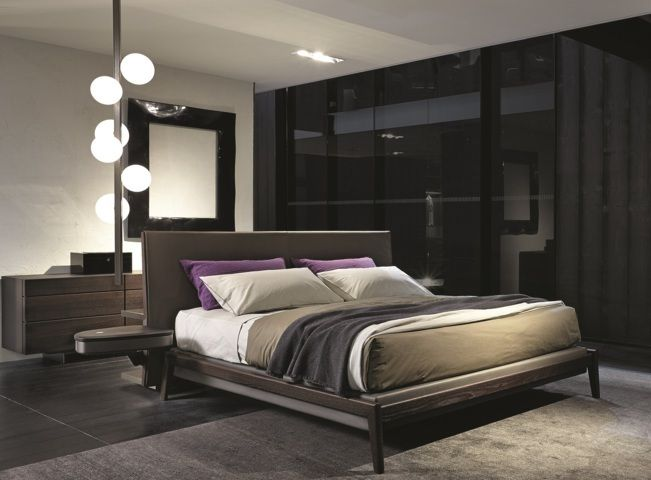 Poliform_Ipanema bed with inner bed frame and headboard covered in leather, structure in solid wood in spessart oak finishing, new integrated bedside tables in spessart oak.