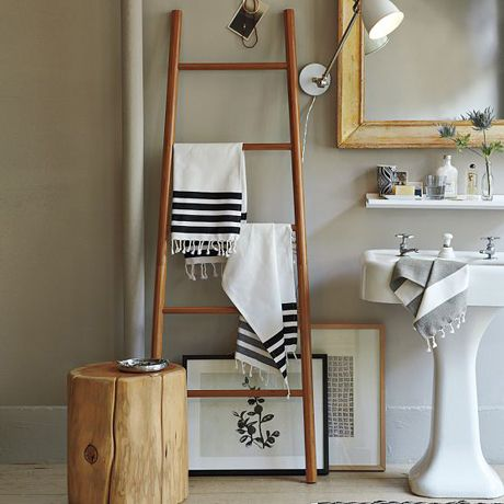 If you're tight on storage space/fixture points in the bathroom, free standing may be the way to go. A wooden ladder is perfect for hanging an array of hand towels and bath towels (while still looking stylish)