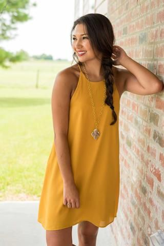 I just love this mustard yellow dress!  I feel like it is the perfect thing to wear to the beach over your bathing suit.  It would also look really good with a long cardigan for the colder weather.