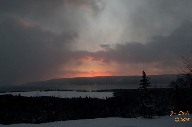 Another snowy and cloudy morning in Cape Breton but there was some colourful moments in the clouds! Jim Steele captured this shot at 7:30 AM. Enjoy!