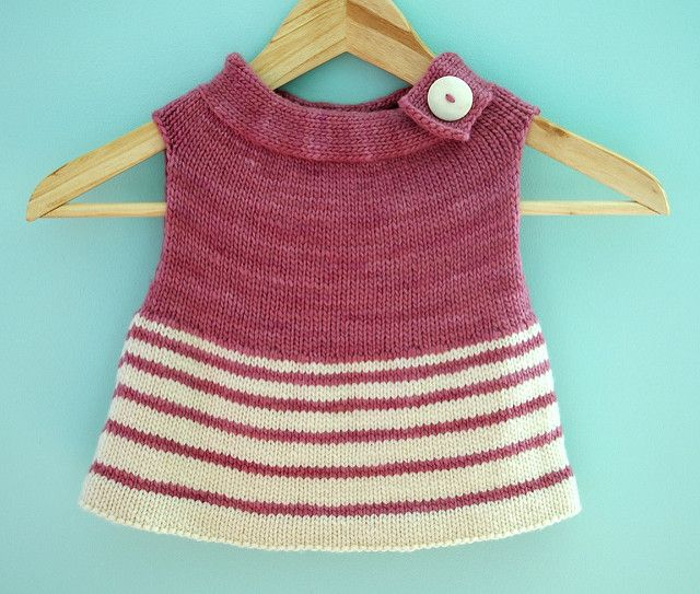 Neighborly is a simple vest sized for a child, intended to keep them warm at their core while not overheating them during all the running about that kiddos do. interest is created by the wide boatneck collar knit in a contrasting yarn which is further accented by a large button. stitches are picked up around the collar's edge and the piece is knit in the round from the top-down — there is no seaming whatsoever and only a bit of additional stitching at the hemline and weaving in the ends…