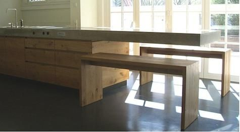 The benches can be tucked under the cantilevered counter when not in use.
