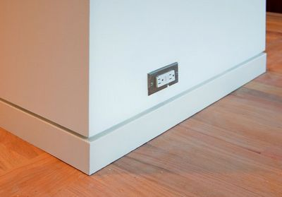 Flush baseboard with shadow line.-Nice detail, however prefer the elimination of the base and the continuance of the wall finish to a shadow reveal above the finish floor.