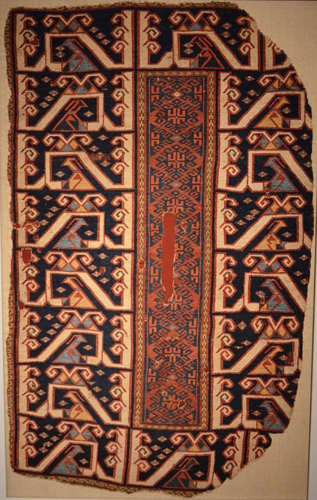 OTTOMAN CARPETS IN THE XVI - XVII CENTURIES (16-17TH CENTURIES) 16th century Anatolian rug fragment with animal figures and kilim features in offset knotting. Berlin Museum of Islamic Arts