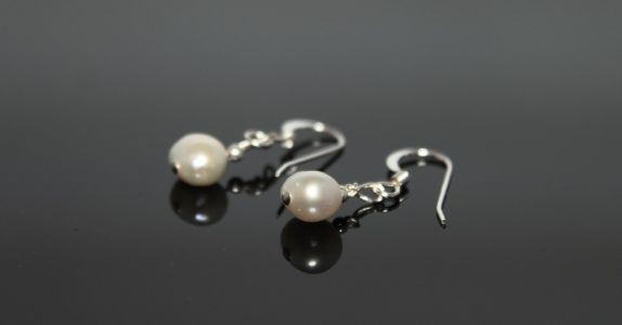 luna earrings.  pretty simple earrings of a single white nugget pearl and a silver ball.  Beautiful accessory to show off an updo.