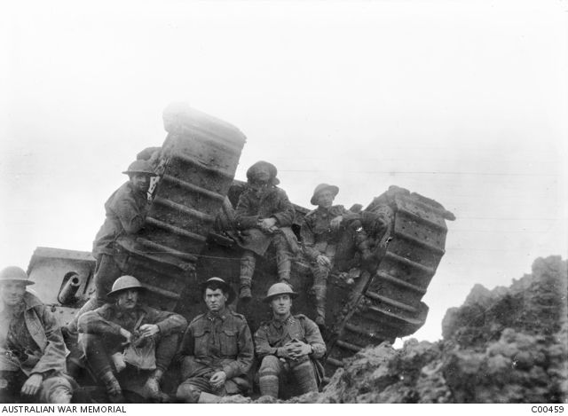 Group portrait of seven unidentified soldiers with a British male Mark IV tank, temporarily out of action, near Westhoek Ridge.  In September 1917 Australian troops were engaged in the battles of Menin Road and Polygon Wood in the vicinity of Ypres. (From the collection of 704 Driver Ernest Charles Barnes who served with the 1st Field Artillery Brigade, 21st Howitzer Brigade and 2nd Field Artillery Brigade.) Western Front (Belgium), Menin Road Area, Westhoek...