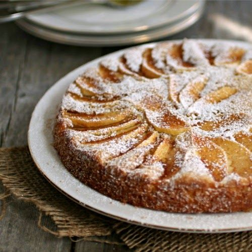 "Simple Apple Cake (Hungry Couple). ""With a moist, just-sweet-enough batter, perfumed with vanilla, and a thin layer of cinnamon apples and powdered sugar on top.  Really, really good simple cake."""