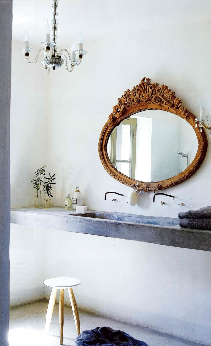 Simple rustic bath with just a touch of sparkle from the light fixtures and the beautiful oval mirror.