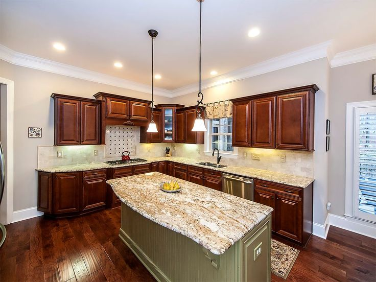 Traditional Kitchen with Walnut - Mediterranean Rustique, Custom hood, Complex granite counters, Stone Tile, Limestone Tile