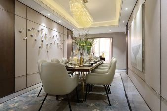 A substantial chandelier sits above the dining room table