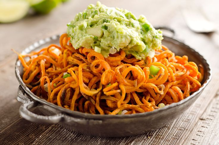 Spicy Roasted Sweet Potato Spirals with Guacamole is an appetizer with crispy sweet potatoes roasted in garlic & chili powder & topped with zesty guacamole.