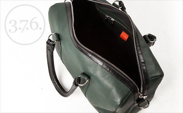 Black fabric inside. Two zipper pockets