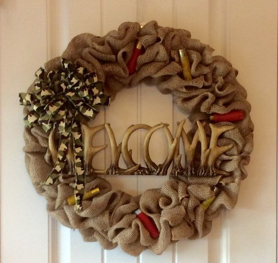 Perfect for the front of a cabin. This 16 burlap Wreath has a deer antler welcome sign accented with camouflage bow and shot gun shells. As with all my wreaths a free hanger is included.